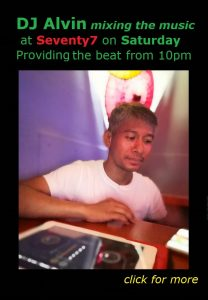 DJ Alvin mixing music at bar